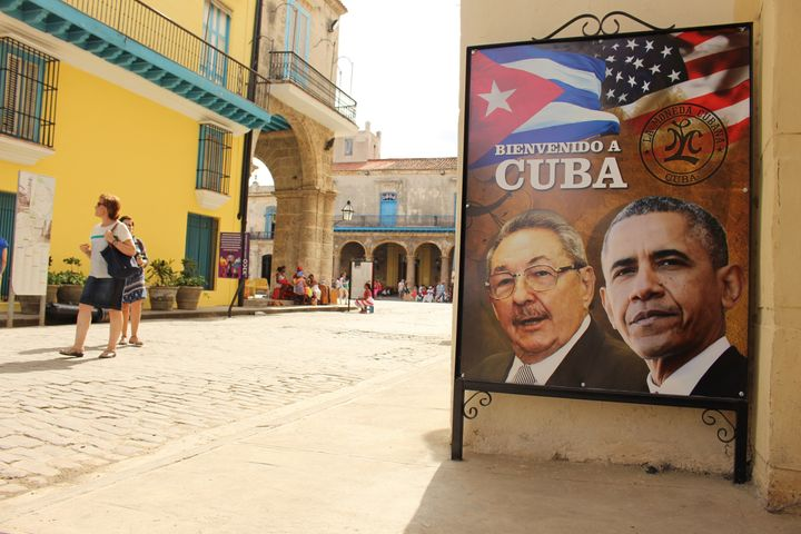 A sign in heavily touristed Old Havana, where Obama will take a walking tour on Sunday, shows him alongside Cuban head of sta