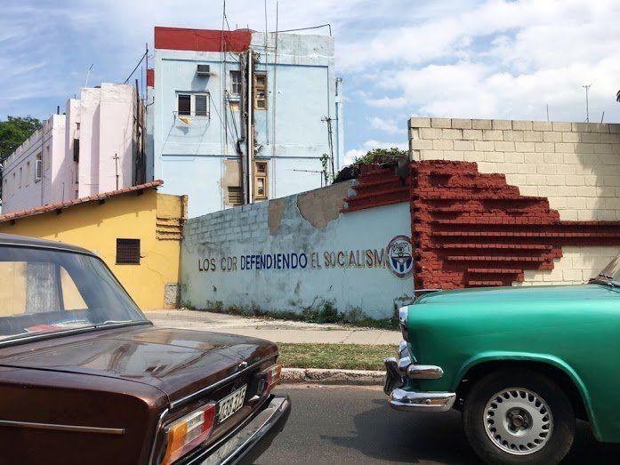 """A government slogan about one of itsbest-known agencies, Los Comites de Defensa de la Revolucion (CDR), reads: """"T"""