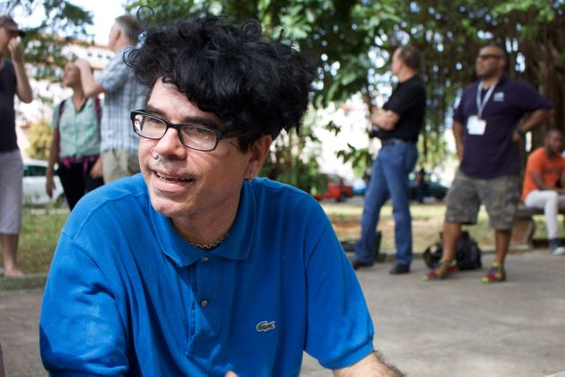 Gorki Aguilar, the frontman for punk band Porno Para Ricardo, sits on a curb in a park next to the Santa...