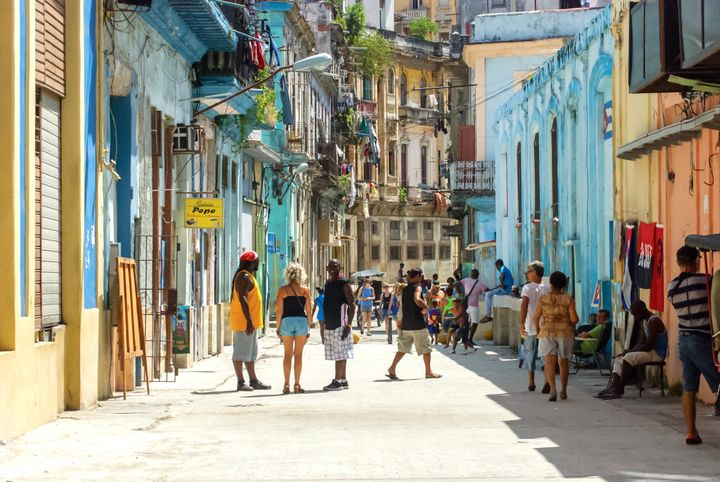 Locals on San Miguel street in Old Havana.