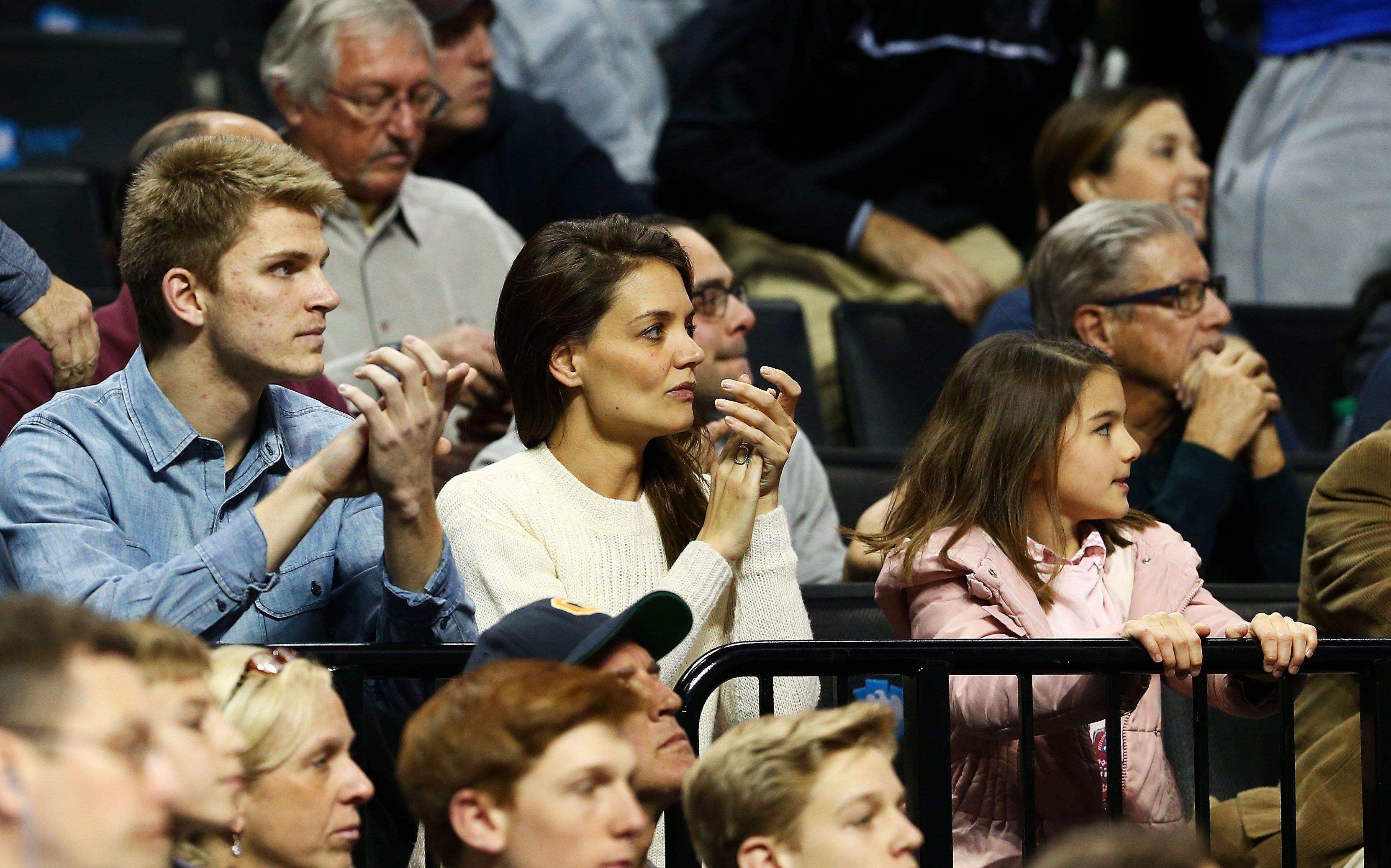 NEW YORK, NY - MARCH 20:  Actress Katie Homes and her daughter Suri Cruise attend the game between the Stephen F. Austin Lumberjacks and the Notre Dame Fighting Irish during the second round of the 2016 NCAA Men's Basketball Tournament at Barclays Center on March 20, 2016 in the Brooklyn borough of New York City.  (Photo by Elsa/Getty Images)