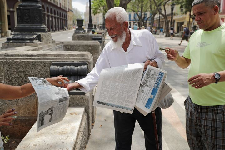 A man sells copies of Cuban state newspaper Juventud Rebelde in Havana on March 20, 2016. Cuba's state-controlled p