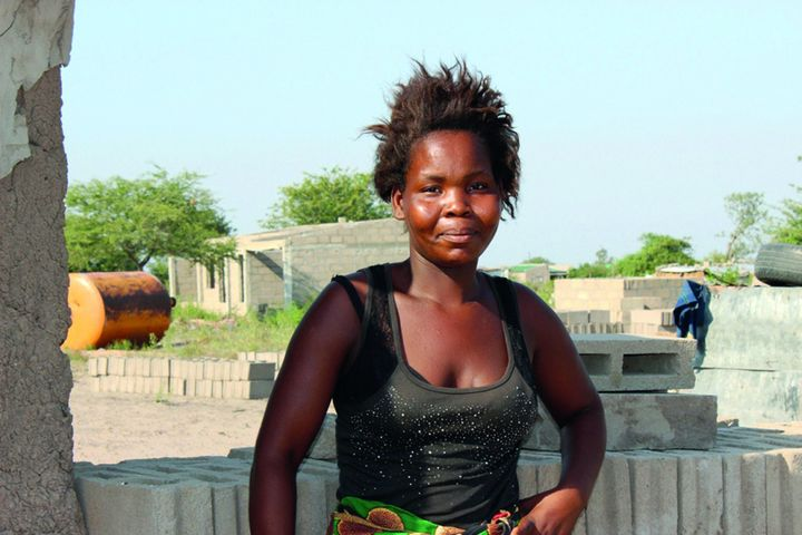 Amelia stands in Boane, on the outskirts of Maputo, Mozambique.