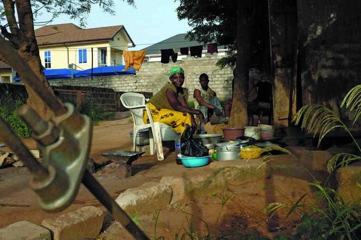Doris Oparebia sits in heryardin Accra, Ghana.