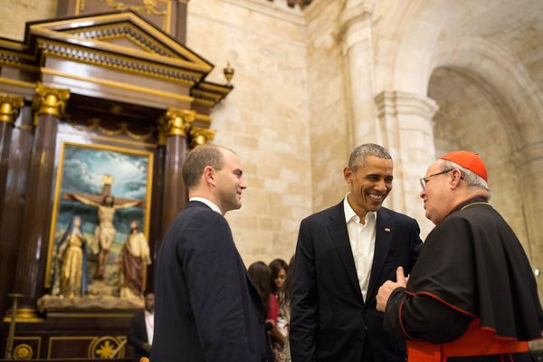 Obama and White House staffer Ben Rhodes talk with Cardinal Jamie Ortega while touring La Catedral de la Virgen Maria de la C