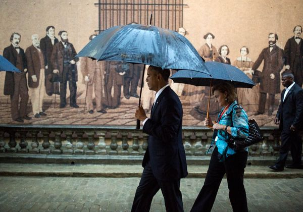 Obama walks through Old Havana.