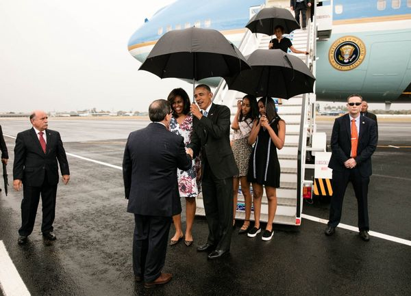 Obama, first lady Michelle Obama, and daughters Malia and Sasha greet dignitaries upon arriving in Havana.