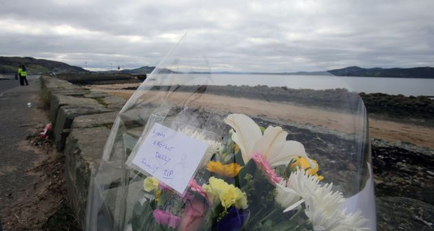 Flowers left at the scene at Buncrana Pier in Co