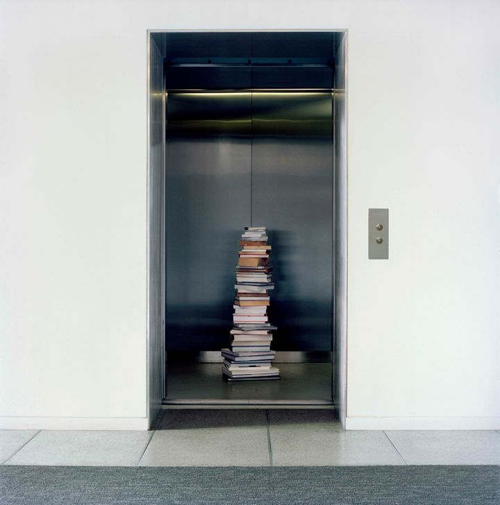 Stack of books left in a building's elevator in the Upper West Side.