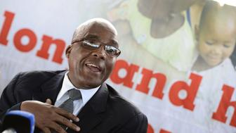 South Africa's Health Minister Aaron Motsoaledi delivers a speech on April 8, 2013 during the launch of the new single dose anti-AIDs drug at Phedisong clinic in Ga-Rankuwa, 100 kms north of Johannesburg. The new pill will simplify the world's biggest HIV treatment regime to just one life-saving pill a day. The new single dose AIDS drug was secured at a record-low price and will cost the state 89 rand a month ($10, eight euros) per patient. After years of refusing to roll out ARVs, South Africa now has 1.9 million people on treatment of its 5.6 million HIV-positive population, which is the world's largest. The new pill will be introduced this month to positive pregnant women and breastfeeding mothers, people co-infected with TB, and to new ARV patients.  AFP PHOTO / STEPHANE DE SAKUTIN        (Photo credit should read STEPHANE DE SAKUTIN/AFP/Getty Images)
