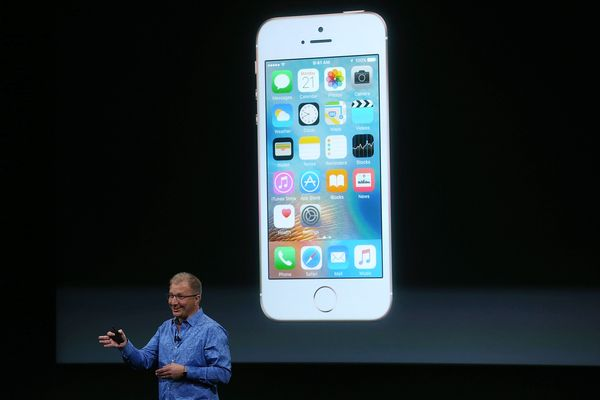 Apple VP Greg Joswiak announces the new iPhone SE during an Apple special event at the Apple headquarters on March 21, 2016,