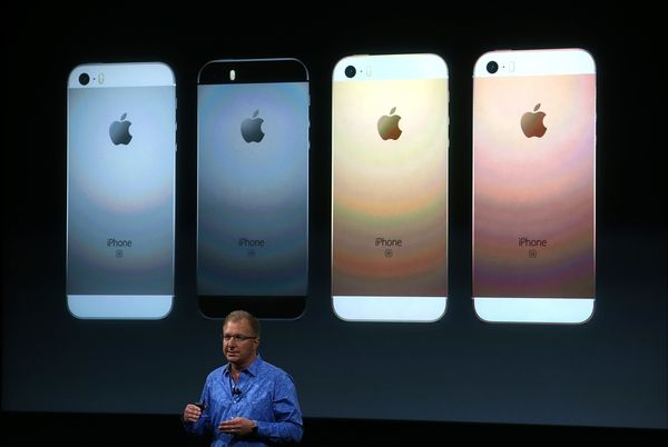 Apple VP Greg Joswiak announces the new iPhone SE during an Apple special event at the Apple headquarters on March 21, 2016,&