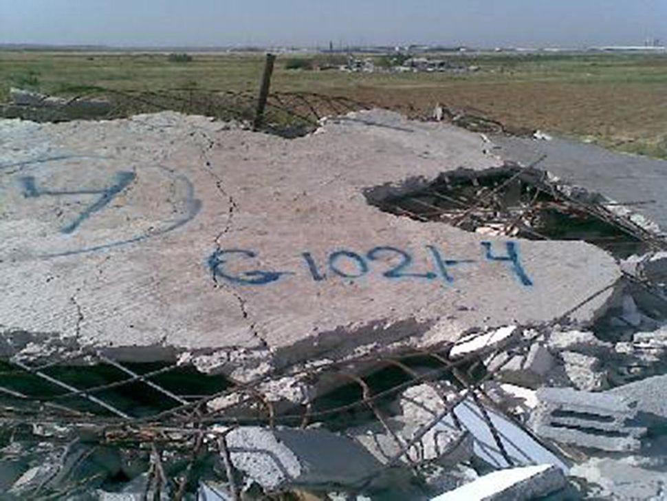 G1021-04 neighborhood: Gaza; near Shuja'iyya; date of destruction: 13 April 2009; method of destruction: bulldozer; date of i