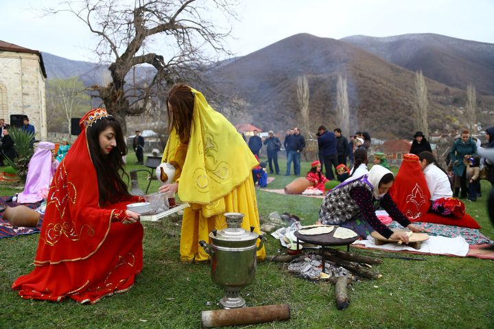 People attend Nowruz celebrations, the traditional Iranian festival of spring which starts at the exact moment of the vernal
