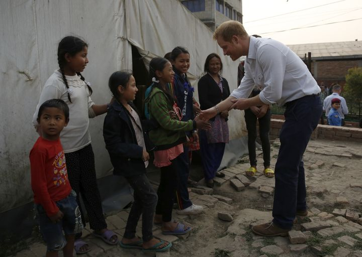 The prince visits Nepalese families displaced by the 2015 earthquakes at a makeshift camp in Bhaktapur.