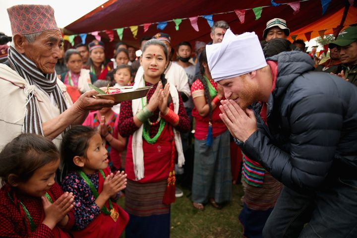 Prince Harry dons his pheta turban after being given the honour of being 'village head man' in Leurani,Nepal.