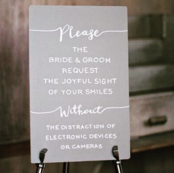 """""""The bride and groom request the joyful sight of your smiles without the distraction of electronic devices or cameras."""""""