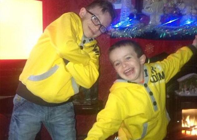Mr McGrotty's sons Mark and Evan who both