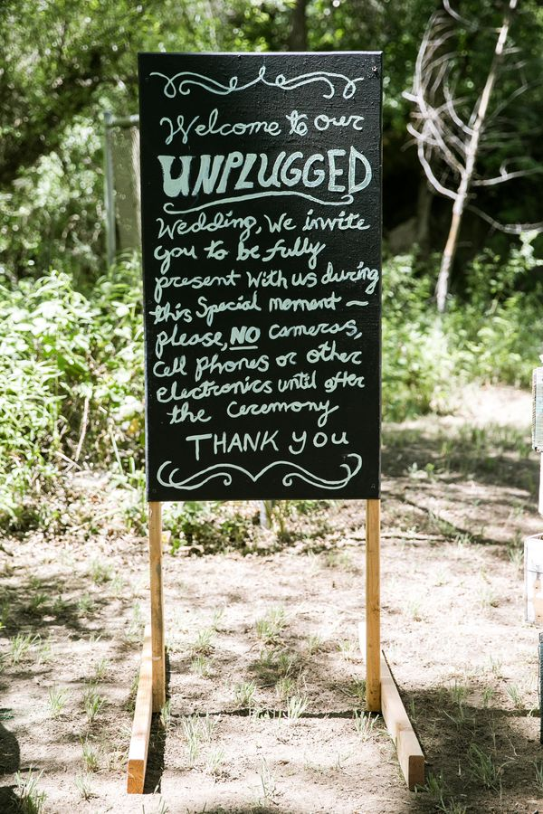 """""""Welcome to our unplugged wedding. We invite you to be fully present with us during this special moment. Please, no cameras,"""