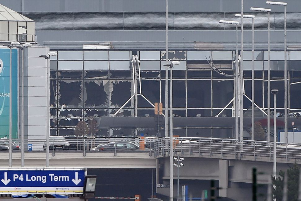 A picture taken in Zaventem on March 22, 2016, shows the damaged facade of Brussels airport.