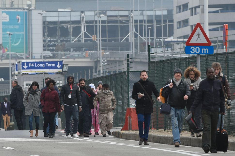Passengers leave Brussels airport in Zaventem on March 22, 2016.