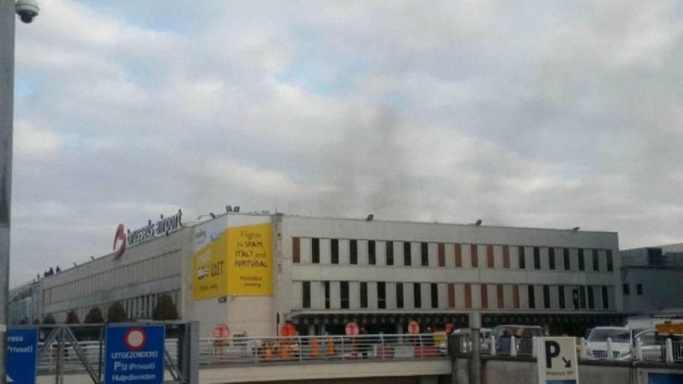 Black smoke is seen rising from the Brussels airport following explosions, in this still image made available March 22, 2016.