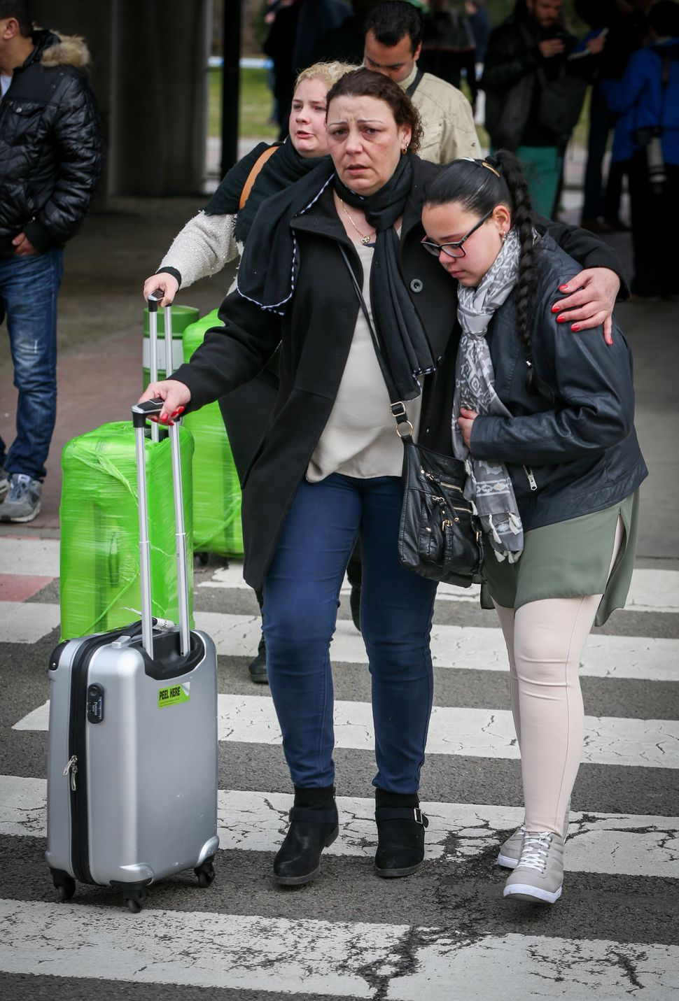People are evacuated from Brussels Airport, in Zaventem, on March 22, 2016.