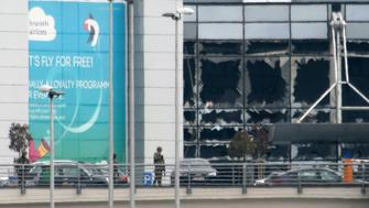 BRUSSELS, BELGIUM - MARCH 22:  Military guard the area as passengers are evacuated from Zaventem Bruxelles International Airport after a terrorist attack on March 22, 2016 in Brussels, Belgium. At least 13 people are though to have been killed after Brussels airport was hit by two explosions whilst a Metro station was also targeted. The attacks come just days after a key suspect in the Paris attacks, Salah Abdeslam, was captured in Brussels. (Photo by Sylvain Lefevre/Getty Images)
