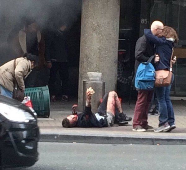 Brussels Attacks: Astonishing Picture Captures Couple Embracing After Metro Station And Airport