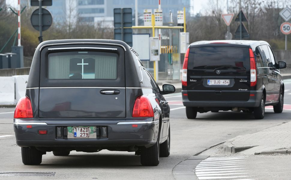 A hearse arrives to Brussels Airport in Zaventem following twin blasts on March 22, 2016.