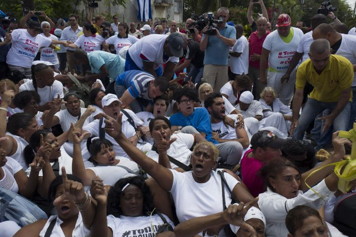 Members of the Ladies in White demonstrate hours before Obama began his visit to Havana. The Cuban government detained some 5