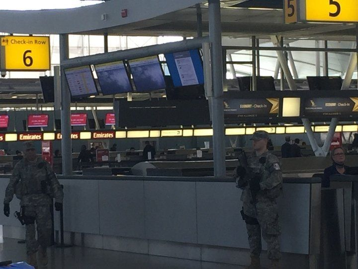 Armed guards are seen patrolling a check-in gate at JFK airport on March, 22, 2016.