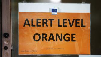 BRUSSELS, BELGIUM - MARCH 22:  Alert Level Orange sign is seen on an EU Commission building following todays attack on March 22, 2016 in Brussels, Belgium. At least 34 people are thought to have been killed after Brussels airport and a Metro station were targeted by explosions. The attacks come just days after a key suspect in the Paris attacks, Salah Abdeslam, was captured in Brussels.  (Photo by Carl Court/Getty Images)