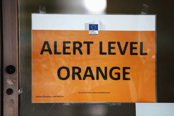 """An """"Alert Level Orange"""" sign is seen on an EU Commission building following terrorist attacks in Brussels, March 22, 2016."""