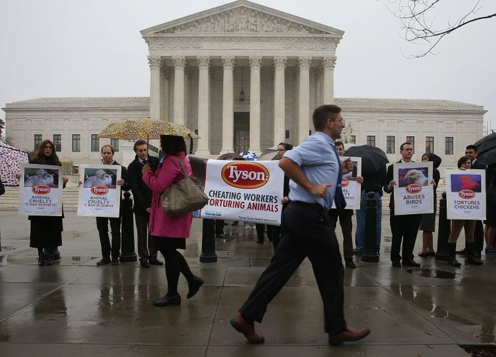 Activists protest against Tyson Foods in front of the Supreme Court on Nov.10, 2015. Meatpacking workers at a Tyson Foo