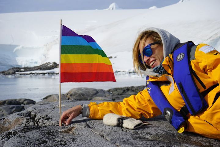 A Planting Peace member plants a flag in Antarctica.