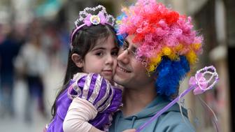 JERUSALEM, ISRAEL - MARCH 17:  People dressed in different costumes celebrate the Jewish holiday of Purim, commemorates the salvation of the Jewish people in ancient Persia from Haman's plot to destroy the Jews, in Jerusalem, Israel on March 17, 2014. (Photo by Salih Zeki Fazlioglu/Anadolu Agency/Getty Images)