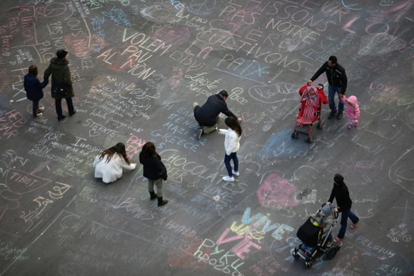 People write messages on the ground at Place de la Bourse (Beursplein) following attacks in Brussels on March 22, 2016.