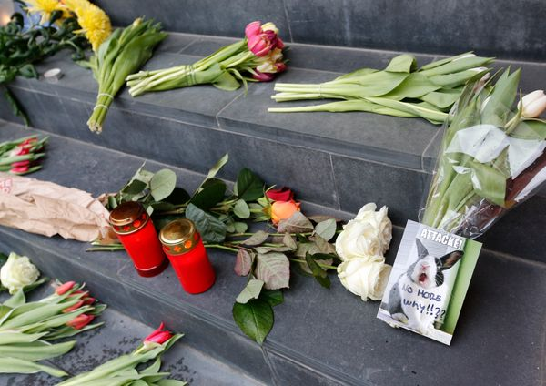 Flowers and candles for the victims of today's Brussels attacks, are placed on the steps of the Belgian embassy in Berlin, Ge
