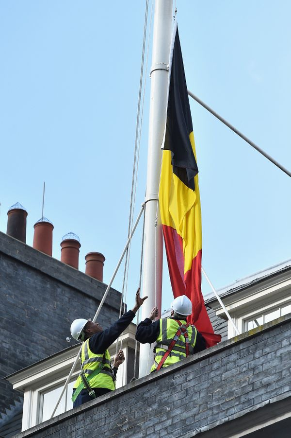 The Belgian national flag is raised as a mark of respect at Downing Street on March 22, 2016, in London, England.
