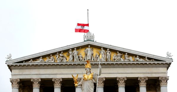 An Austrian national flag flies at half mast in commemoration of the victims of today's Brussels attacks, on top of Parliamen