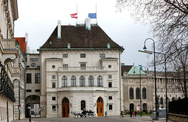 A European Union flag and an Austrian national flag fly at half mast in commemoration of the victims of theBrussels att