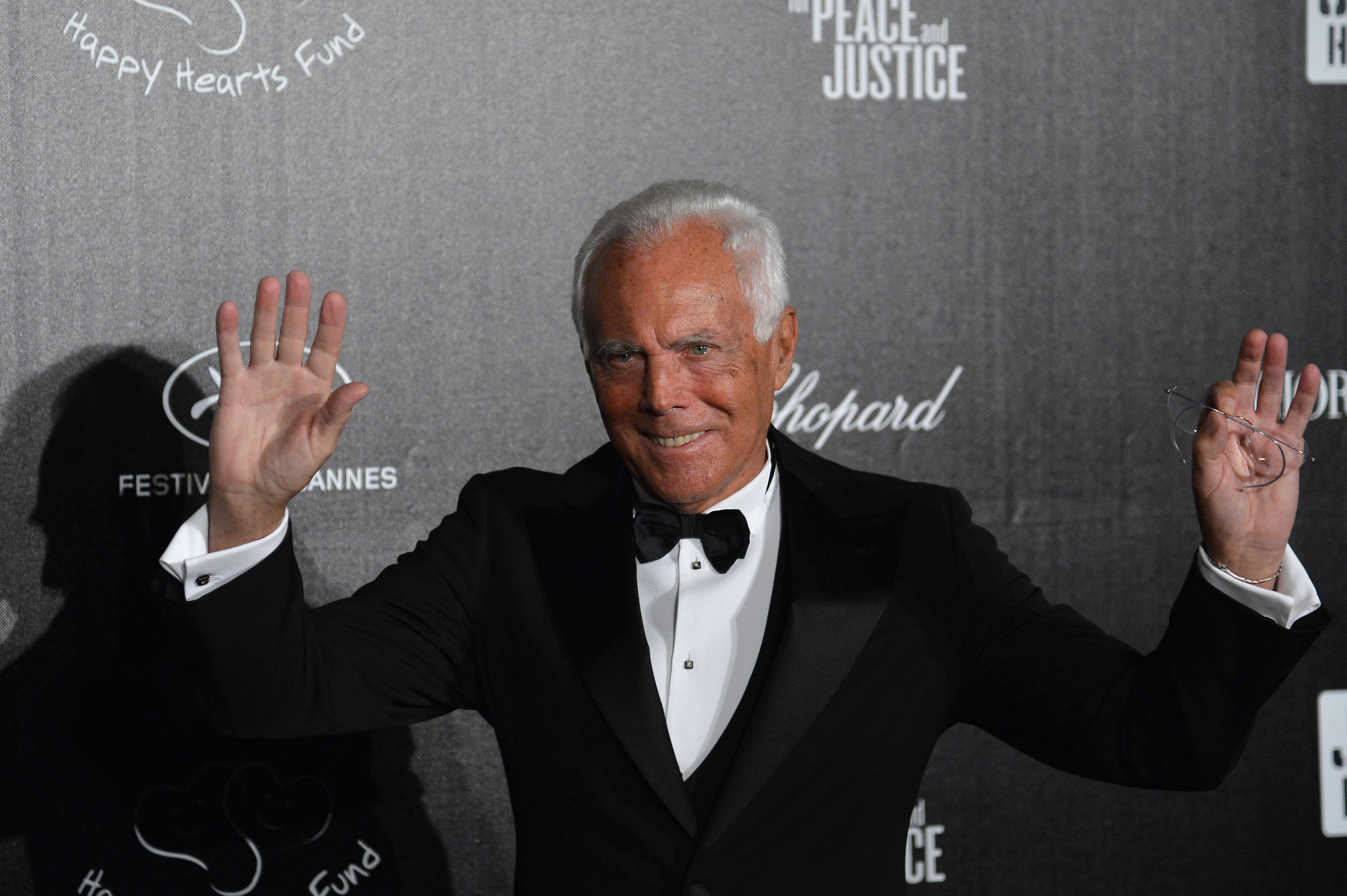 Italian designer Giorgio Armani arrives for an event to raise money for charities working in Haiti, at the 65th Cannes film festival on May 18, 2012 in Cannes.   AFP PHOTO / ALBERTO PIZZOLI        (Photo credit should read ALBERTO PIZZOLI/AFP/GettyImages)