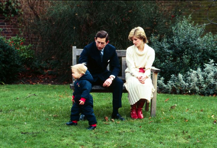 Prince Charles and Princess Diana with Prince William in Kensington Palace gardens in December 1983.