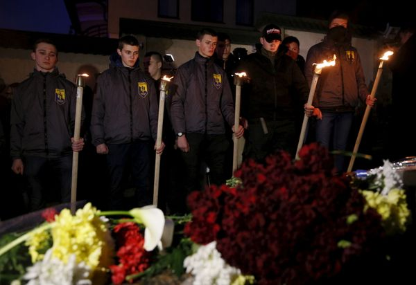 Activists of the Azov civil corp commemorate the victims of Tuesday's Brussels attacks near the Belgian embassy in Kiev, Ukra