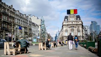 The Belgian national colours are seen on a billboard at the Place de Brouckere square in the city center of Brussels on March 22, 2016, in Brussels, following triple bomb attacks in the Belgian capital that killed about 35 people and left more than 200 people wounded.  A series of explosions claimed by the Islamic State group ripped through Brussels airport and a metro train on March 22, killing around 35 people in the latest attacks to bring bloody carnage to the heart of Europe. / AFP / Belga / PHILIPPE FRANCOIS / Belgium OUT        (Photo credit should read PHILIPPE FRANCOIS/AFP/Getty Images)