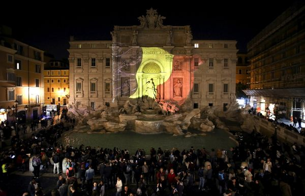 The black, yellow, and red colors of the Belgian flag are projected on the Trevi fountain in Rome, Italy, in tribute to the v