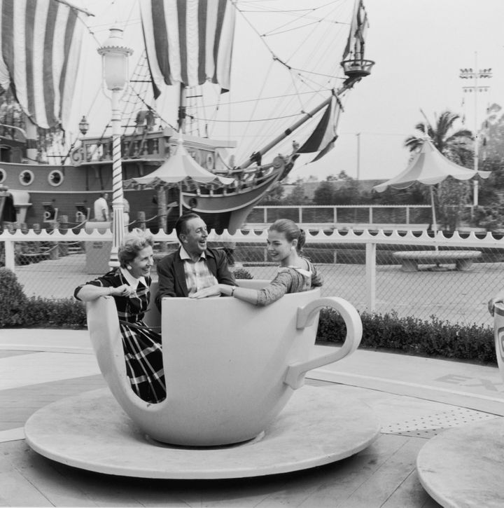 Lillian Disney and her husband, Walt Disney, take one of Disneyland's spinning tea cups for a ride with their daughter, Diane