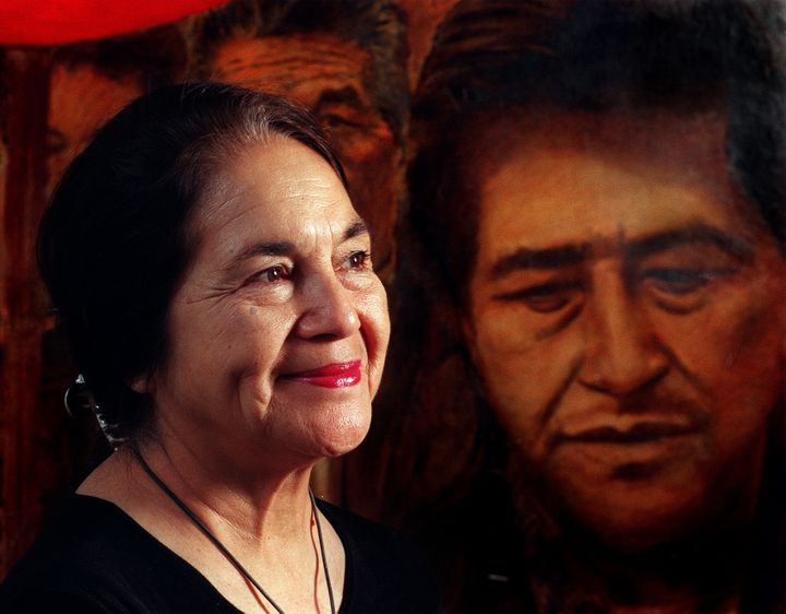 Dolores Huerta appears before a painting of her dear friend, Cesar Chavez.