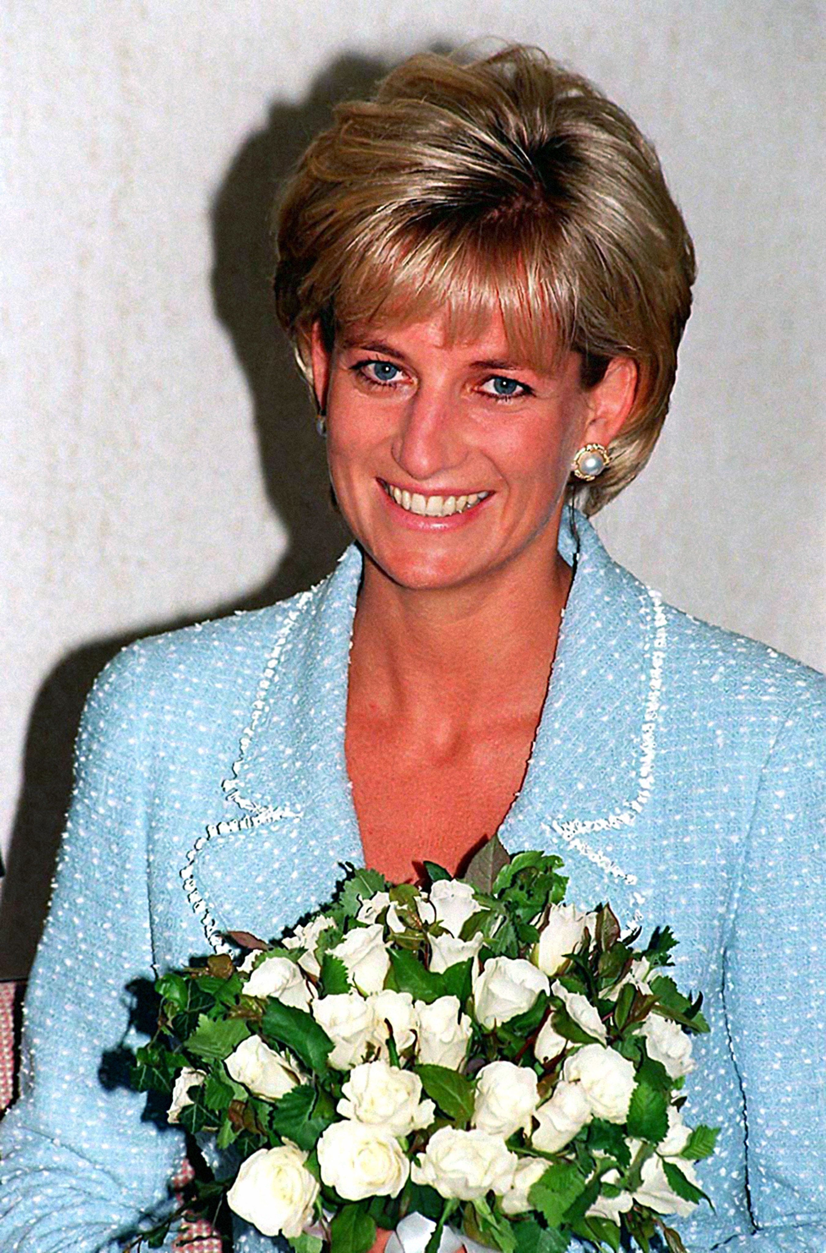 Note to Editors:  This picture transmitted 17 August 1998 to accompany package of stories in advance of the first anniversary of the death of Diana, Princess of Wales. Library file, dated 21/4/97.of  Diana, Princess of Wales, with the first rose to be named after her at the British Lung Foundation offices in central London. The British Lung Foundation launched the first Princess of Wales Rose Day - 1st July - the Princess' birthday, to commemorate her support for the charity over ten years. Pool Photo by John Stillwell/PA.